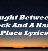 Caught Between A Rock And A Hard Place Lyrics