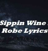 Im Sippin Wine In A Robe Lyrics
